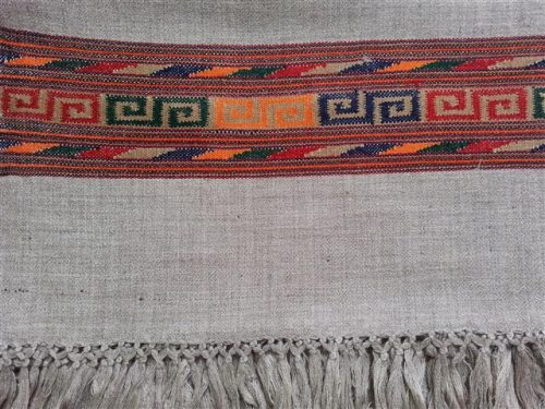 Pale grey shawl with red geometric border - detail