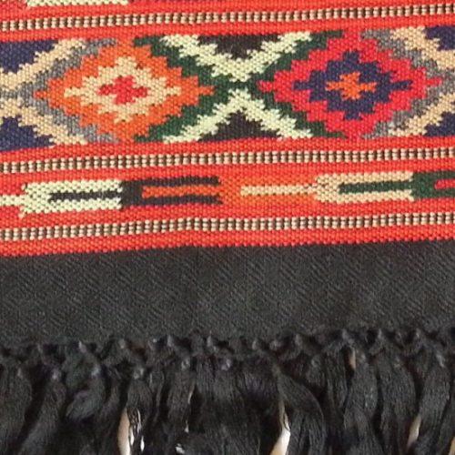 Black shawl red border close up